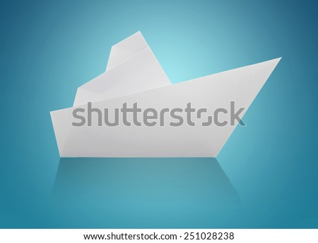 White Origami Paper Ship on Blue Background