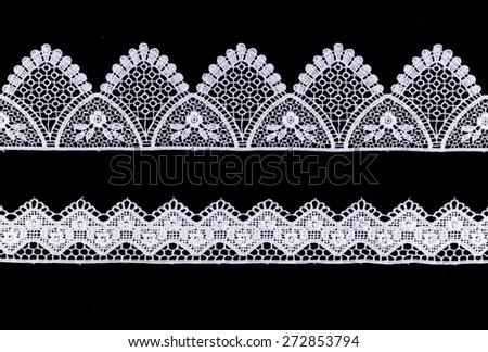 White Ornamental Lace isolated on black background - stock photo