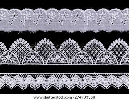 White Ornamental Lace isolated on black background