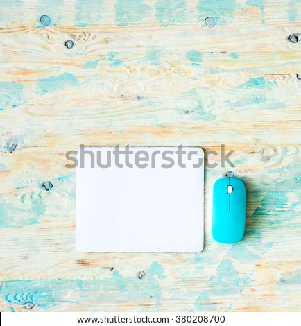 white pad with blue mouse - stock photo