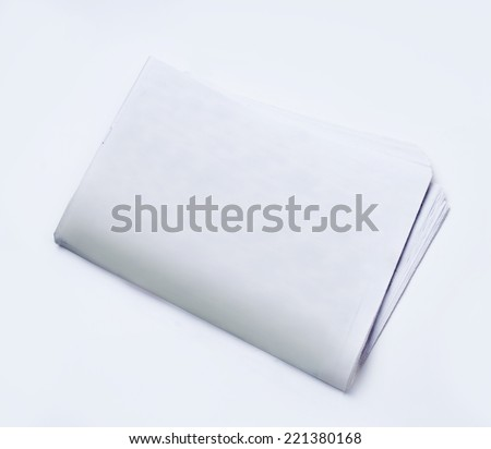 white pages of a newspaper folded on a white background