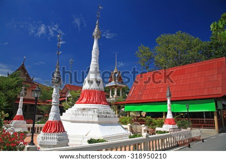 White pagodas against blue sky at wat Bang Chak in Nonthaburi province, Thailand - stock photo