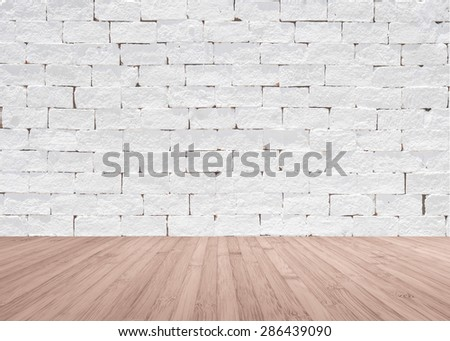 White painted brick wall texture with wooden floor in light red brown color tone for interior background : Masonry brickwork wall pattern with wood flooring  - stock photo