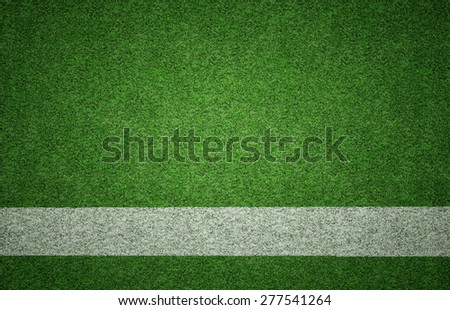 White painted line on green grass background texture with grunge lighting and lots of copy space. Perfect for sport designs. - stock photo