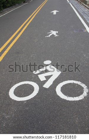 White painted signs for bike and rollerblades line