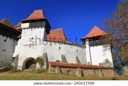 White painted walls of a church listed on UNESCO world heritage in Viscri village, Transylvania, Romania - stock photo