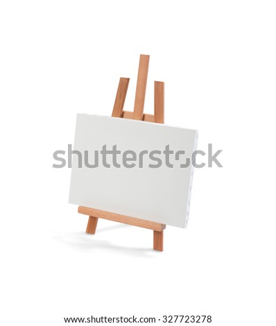 White painter canvas on wooden easel isolated on white