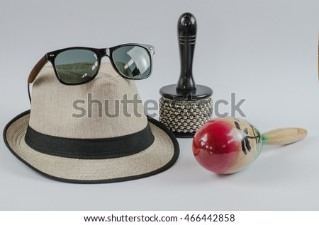 White panama hat and sunglasses percussion  isolated on white background