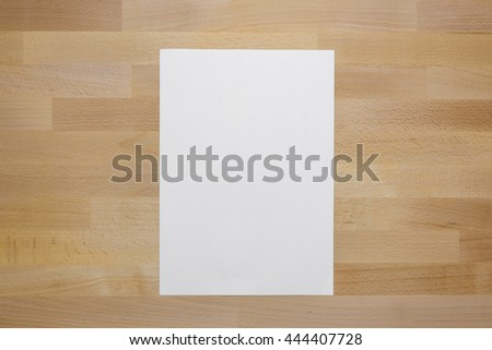 White Paper A4 with Copy Space Around for Details,Words,Graphic on Top View of Vintage Color Tone Style Macro and Details Wood Texture Table or Desk  - stock photo