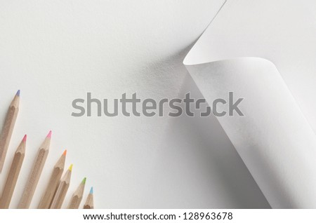 White paper and colored pencils - stock photo
