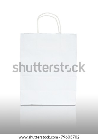 white paper bag on reflect floor and white background - stock photo