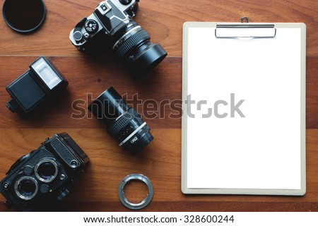 White paper board and photography tool. Concept for application form or other message. - stock photo