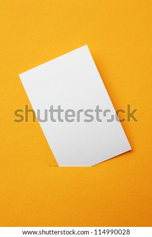 white paper card on orange background - stock photo