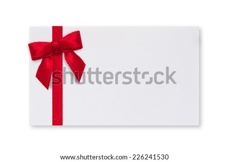 White paper card with a red bow on a white background. - stock photo