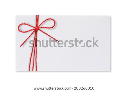 White paper card with a red rope bow on a white background. - stock photo