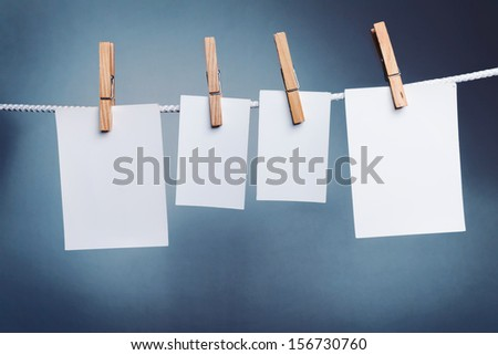 White paper cards on clothes-pegs  - stock photo