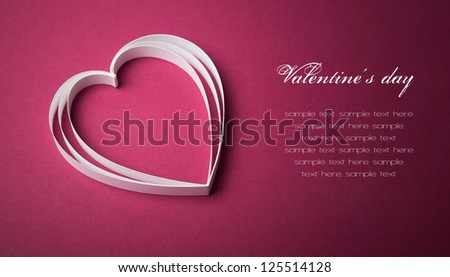 White paper heart on the purple with copy space - stock photo