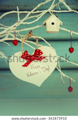 White paper heart Valentines day card on a turquoise background. - stock photo