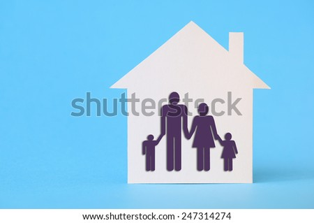 White paper house on blue with family symbol - stock photo