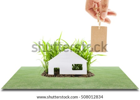 White paper house on Young green grass growing out of the ground, isolated on white background,Concept house and nature,house and nature,advertising and Sales
