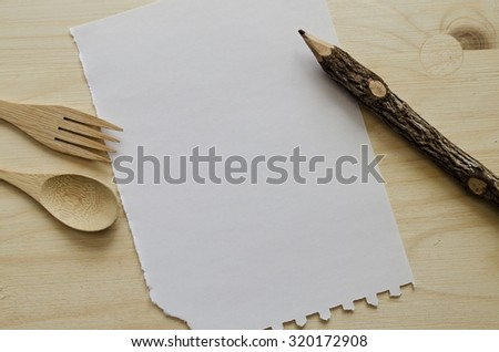 White paper note for writing with wooden fork and spoon - stock photo