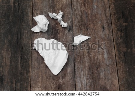 white paper note rip Pieces and crumpled on a wooden background  - stock photo