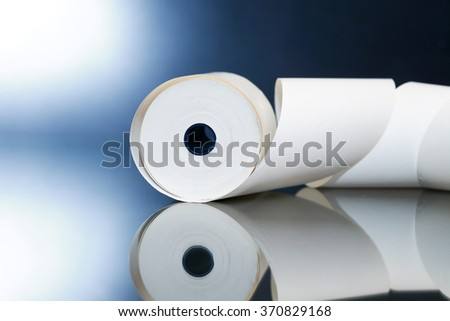 White paper roll with reverberation on dark background - stock photo