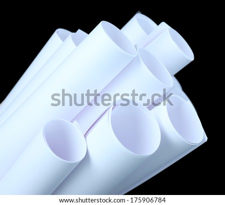 White paper rolls on black background close-up - stock photo