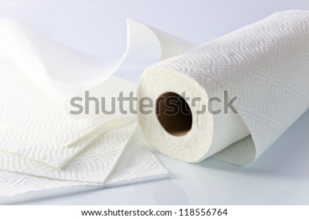 White paper towel on a white reflective background. - stock photo
