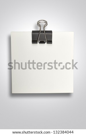 White paper with binder clip (clipping path) - stock photo