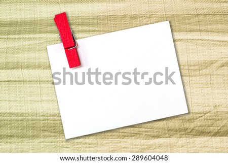 white paper with wood clip on canvas texture background empty blank for text. - stock photo