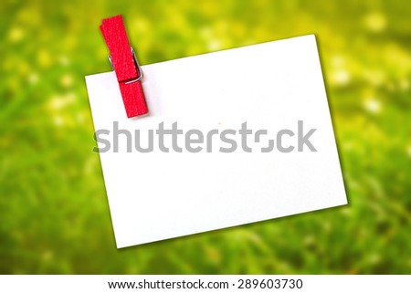 white paper with wood clip on empty blank for text. - stock photo