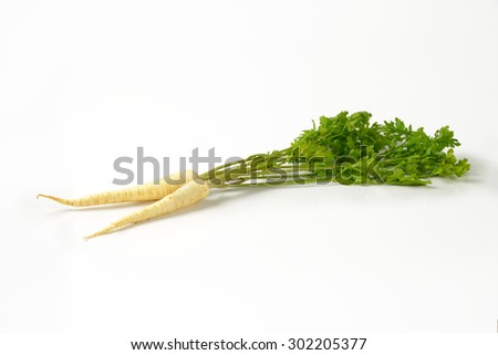 white parsley roots on white background