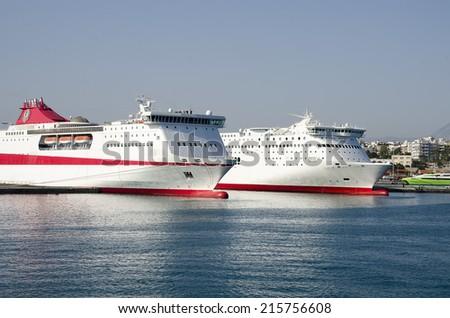 White passenger cruise ship against blue sky in the port - stock photo