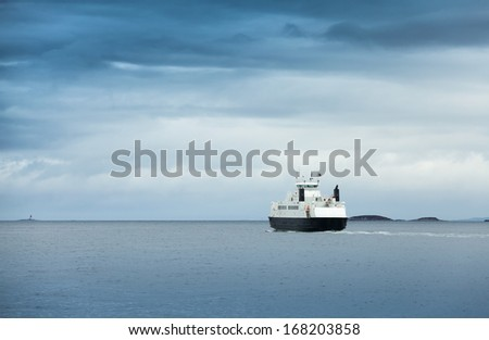 White passenger ferry in overcast weather in Norwegian sea