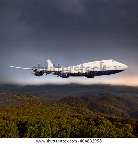 White passenger wide-body plane. Aircraft is flying over the hills at sunset. - stock photo