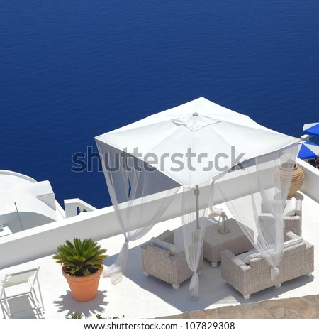 white pavilion in luxurious resort on the cliff of Santorini, Greece - stock photo