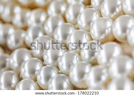 White pearl necklace as background