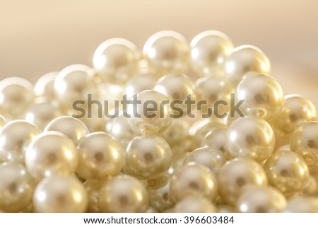 White pearl necklace as background in closeup - stock photo