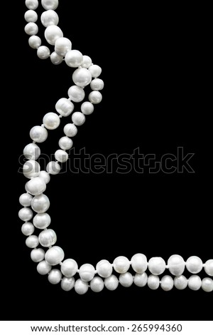 White pearl strings over black as a background - stock photo