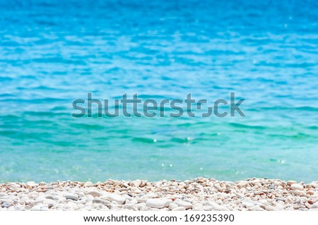 White pebbles on the sea beach - stock photo