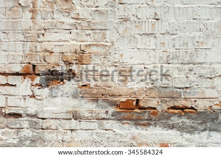 White peeled brick wall texture background. Vintage effect. - stock photo