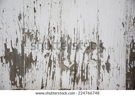 White peeling paint from old wooden surface -- rusty and weathered - stock photo