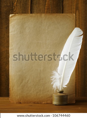 White pen in the ink and old paper - stock photo