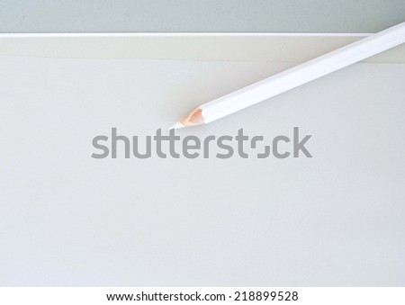 white pencil isolated on a graphic background