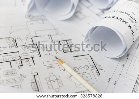 white pencil on architectural for construction drawings  with roll of blueprint - stock photo