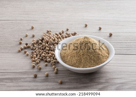 White pepper on wooden texture background - stock photo