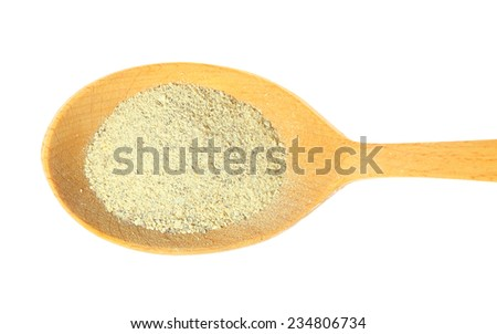 White pepper powder on a wooden spoon isolated on white background - stock photo