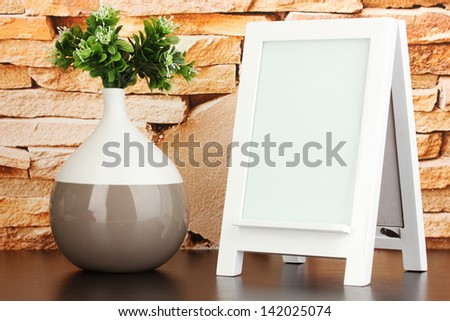 White photo frame for home decoration on stone wall background - stock photo