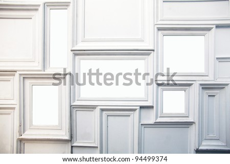 White photo frame on the wall - stock photo